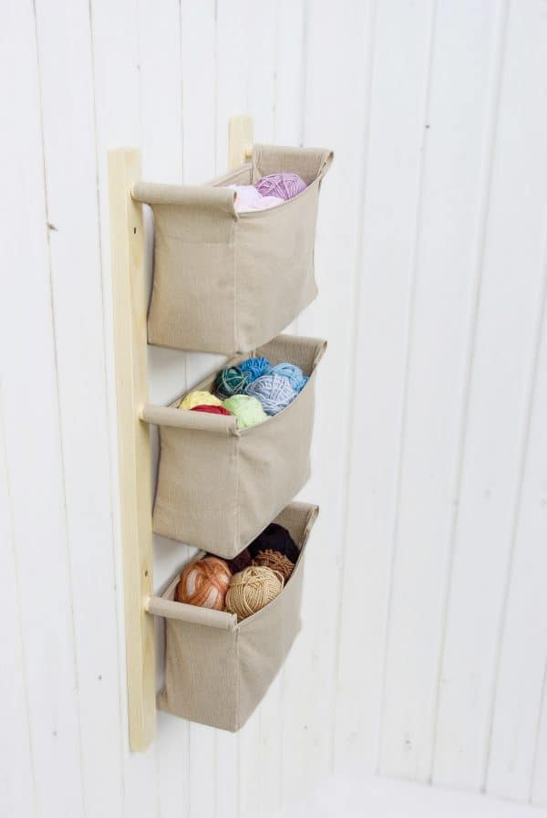 earth tones nursery room organizer with storage bins